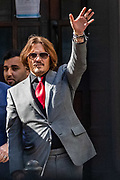 American actor Johnny Depp wave as he leaves the High Court in London on Tuesday, July 21, 2020. Amber Heard started Monday to give evidence at the High Court in London as part of Johnny Depp's libel case against The Sun over allegations of domestic violence during the couple's relationship. (VXP Photo/ Vudi Xhymshiti)