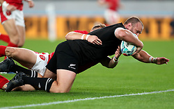 New Zealand's Joe Moody holds off Wales' Hallam Amos to score his sides first try during the 2019 Rugby World Cup bronze final match at Tokyo Stadium.