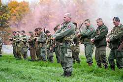 Reenactors from the Northern World War Two Association (NWW2A) hold a minuets silence after the battle re-enactment held on Pickering Showground during the 1940;s Wartime Weekend<br /> <br /> 17/18 October 2015<br />  Image © Paul David Drabble <br />  www.pauldaviddrabble.co.uk