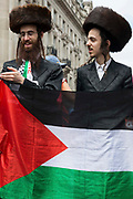 Ultra-Orthodox anti-Zionist Haredi Jews from Neturei Karta UK stand holding a Palestinian flag during a United Against The Tories national demonstration organised by the Peoples Assembly Against Austerity in protest against the policies of Prime Minister Boris Johnsons Conservative government on 26th June 2021 in London, United Kingdom. The demonstration contained blocs from organisations and groups including Palestine Solidarity Campaign, Stand Up To Racism, Stop The War Coalition, Extinction Rebellion, Kill The Bill and Black Lives Matter as well as from trade unions Unite and the CWU.