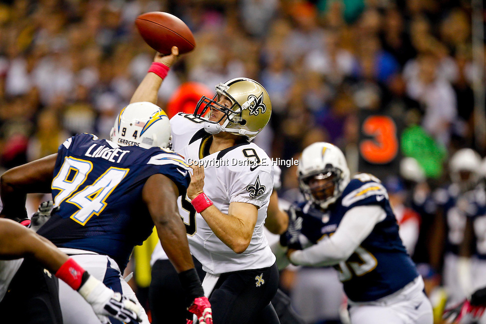 October 7, 2012; New Orleans, LA, USA; New Orleans Saints quarterback Drew Brees (9) throws against the San Diego Chargers during the first quarter of a game at the Mercedes-Benz Superdome. Mandatory Credit: Derick E. Hingle-US PRESSWIRE