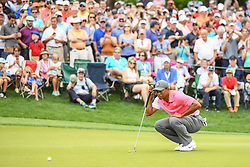 May 5, 2018 - Charlotte, NC, U.S. - CHARLOTTE, NC - MAY 05: Tiger Wood reads his putt on the 15th green during the 3rd round of the Wells Fargo Championship on May 05, 2018 at Quail Hollow Club in Charlotte, NC. (Photo by William Howard/Icon Sportswire) (Credit Image: © William Howard/Icon SMI via ZUMA Press)