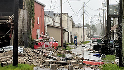 October 10, 2018 - Port Saint Joe, Florida, U.S. - The wall of a warehouse lay in ruins in the alleyway of a row of downtown businesses in Port Saint Joe on Wednesday afternoon after Hurricane Michael made landfall in the Florida Panhandle. Hurricane Michael formed off the coast of Cuba carrying major Category 4 landfall in the Florida Panhandle. Surge in the Big Bend area, along with catastrophic winds at 155mph. (Credit Image: © Douglas R. Clifford/Tampa Bay Times via ZUMA Wire)