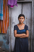 Portrait of Lila, a young woman, resident of the Tangra district, who is studying withthe goal of becoming a police officer, Tangra slum, Dhipi, Kolkata, India