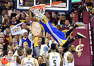 Jun 16, 2015; Cleveland, OH, USA; Golden State Warriors guard Andre Iguodala (9) dunks against Cleveland Cavaliers forward James Jones (1), guard Matthew Dellavedova (8), guard J.R. Smith (5), and forward LeBron James (23) during the third quarter of game six of the NBA Finals at Quicken Loans Arena. David Richard-USA TODAY Sports