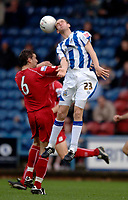 Photo: Glyn Thomas.<br />Huddersfield Town v Welling United. The FA Cup. 06/11/2005.<br />Huddersfield's Andrew Booth (R) jumps higher than Welling's Lee Shearer.