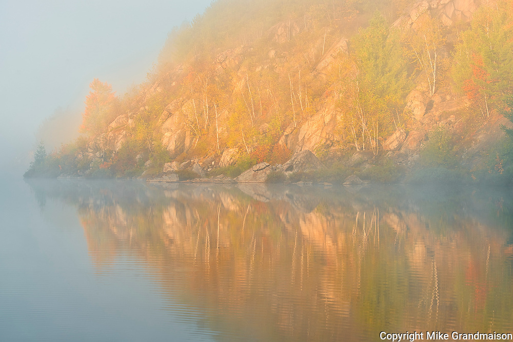 Autumn colors  reflected in Lake Laurentian on an early foggy morning<br />Sudbury<br />Ontario<br />Canada