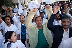 © under license to London News Pictures.  18/02/2011. Doctors and nurses protests against the Ministry of Health at Slamaniya Medical Complex in Manama, Bahrain during heavy unrest. Photo credit should read Michael Graae/London News Pictures