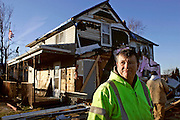 Tim Collins cleans up from the tornado Tuesday, Nov. 23, 2010, at the home he shares with his mother in Caledonia.<br /> SCOTT MORGAN   ROCKFORD REGISTER STAR