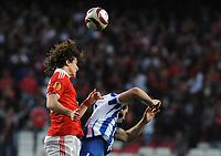 20100223: LISBON, PORTUGAL - SL Benfica vs Hertha Berlin: Europa League 2009/2010 - Round of 32 - 2nd leg. In picture: David Luiz (Benfica) and Fanis Gekas (Hertha BSC Berlin). PHOTO: Alvaro Isidoro/CITYFILES