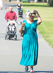 ©Licensed to London News Pictures 22/06/2020<br /> Greenwich, UK. A young lady wearing a long blue summer dress and hat. A warm sunny day in Greenwich park, Greenwich, London. The UK to enjoy hot heatwave weather this week with temperatures set to bring the hottest day of the year so far. Photo credit: Grant Falvey/LNP