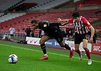 Football - 2020 / 2021 Sky Bet League One - Sunderland vs Milton Keynes Dons - Stadium of Light<br /> <br /> Carlton Morris of Milton Keynes Dons vies with Luke O'Nien of Sunderland<br /> <br /> <br /> COLORSPORT/BRUCE WHITE