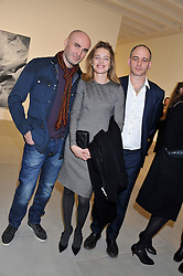 Left to right, JASON BROOKS, NATALIA VODIANOVA and DINOS CHAPMAN at a private view of work by Mat Collishaw - 'This is Not an Exit' held at Blaine/Southern, 4 Hanover Square, London on 13th February 2013.
