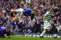Rangers v Celtic, Scottish Premier.<br />Pic Ian Stewart, November 26th, 2000.<br />Tore Andre Flo flies through the air after colliding with keeper Rab Douglas (Photo: Digitalsport)
