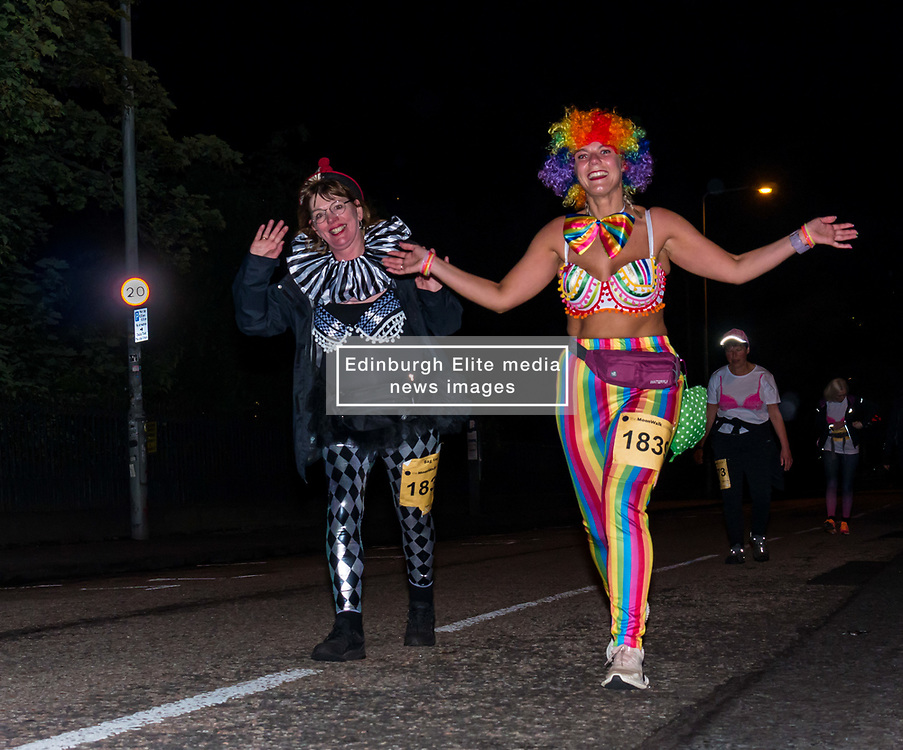 Pictured: Moonwalk Scotland, Edinburgh, Scotland, United Kingdom, 08 June 2019. The 14th Moonwalk Scotland 'Walk the Walk' night-time event with several thousand participants wearing specially decorated bras with a circus theme choose between New Moon (6.55 Miles), Half Moon Marathon (13.1 Miles), Full Moon Marathon (26.2 miles) and Over The Moon (52.4 Miles) to raise money  and awareness for breast cancer causes. The Moonwalkers en route.<br /> <br /> Sally Anderson | EdinburghElitemedia.co.uk