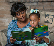 Odella Colbert reads with her granddaughter Devin, January 22, 2015.
