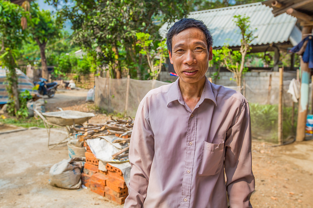 CAPTION: Chung lives in Coong village with his wife and two-year-old son. Like many of their neighbours, their main source of income derives from rice cultivation and the rearing of pigs and chickens. Prior to the project intervention, Chung was only able to sell his produce locally and was subject to low and unstable prices; he was also unable to sell in large quantities. LOCATION: Coong Village, Huy Tuong, Son La Province, Vietnam. INDIVIDUAL(S) PHOTOGRAPHED: Vi Van Chung.