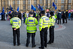 London, UK. 9th January, 2019. Police officers observe rival protests by activists from pro-Brexit group Yellow Vests UK and anti-Brexit group SODEM (Stand of Defiance European Movement) outside Parliament on the first day of the debate in the House of Commons on Prime Minister Theresa May's proposed Brexit withdrawal agreement. Policing arrangements outside Parliament have been strengthened following complaints regarding harassment of MPs by Yellow Vests UK organisers.