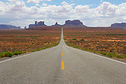 Wide angle view of deserted highway leading to Monument Valley, Navajo Tribal land, Utah