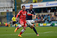 Adam Le Fondre of Cardiff City breaking away from Mark Beevers of Millwall. Skybet football league championship match , Millwall v Cardiff city at the Den in Millwall, London on Saturday 25th October 2014.<br /> pic by John Patrick Fletcher, Andrew Orchard sports photography.