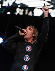 "© Licensed to London News Pictures. 07/06/2013. London, UK.   Ian Brown of The Stone Roses performing live at Finsbury Park. The Stone Roses are an English rock band formed in Manchester in 1983, consisting of vocalist Ian Brown, guitarist John Squire, bassist Gary ""Mani"" Mounfield, and drummer Alan ""Reni"" Wren. They were one of the pioneering groups of the Madchester movement that was active during the late 1980s and early 1990s.   Photo credit : Richard Isaac/LNP"