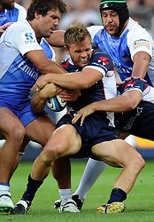 Feb. 15, 2013 - Melbourne, Victoria, Australia - LACHLAN MITCHELL of the Melbourne Rebels is tackled during the round 1 match against Western Force during the 2013 Super XV season at AAMI Park. The Rebels beat the Force 30-23. (Credit Image: © Theo Karanikos/ZUMAPRESS.com)