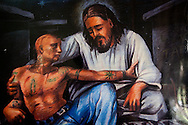 A painting in one of the few centers devoted to gang prevention, and helping youth leave gangs. The center is run by a Catholic priest. The government has no such program.