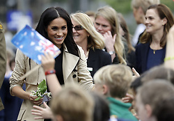 The Duchess of Sussex greets children during a visit to Albert Park Primary School in Melbourne, on the third day of the royal couple's visit to Australia.