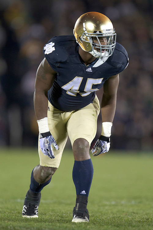 Notre Dame outside linebacker Darius Fleming (#45) sets at the line of scrimmage during third quarter of NCAA football game between Notre Dame and Boston College.  The Notre Dame Fighting Irish defeated the Boston College Eagles 16-14 in game at Notre Dame Stadium in South Bend, Indiana.