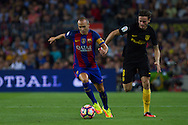 Andres Iniesta dribbles Gabi during the La Liga match between Barcelona and Atletico Madrid at Camp Nou, Barcelona, Spain on 21 September 2016. Photo by Eric Alonso.