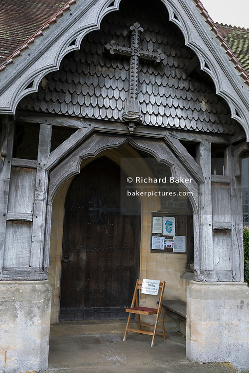 A chair and note welcomes visitors to St. Michael and All Angels church, asking them to close the door after them, on 10th September 2018, in Lingen, Herefordshire, England UK.