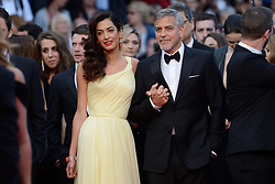 """File photo : George Clooney and his wife Amal Clooney attending the Money Monster screeningat the Palais Des Festivals in Cannes, France on May 12, 2016, as part of the 69th Cannes Film Festival. Amal Clooney and her husband George are expecting twins, US media report. The babies are due in June, according to CBS's The Talk host Julie Chen. Another source close to the couple, quoted by People, said they were """"very happy"""". The Clooneys' representatives have not yet commented. Photo by Aurore Marechal/ABACAPRESS.COM"""
