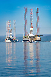 Oil rigs / drilling platforms moored in Cromarty Firth in Ross and Cromarty, Highland, Scotland, United Kingdom