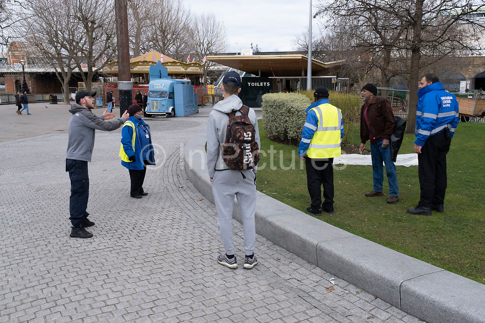 Two men arguing after having an altercation on the South Bank on 5th March 2021 in London, England, United Kingdom. The disagreement, which started when the man on the left threw water onto the man in the brown jacket for urinating behind a bush. They went on to have a fight and security were called.