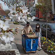 George Washington University freshmen Shuqing Qi, right, and zhiyuan zhong move their belongings after removing them from their dorms in Foggy Bottom in Washington, DC on March 19, 2020. The university has suspended face-to-face instruction and moved classes online to stop the spread of coronavirus.