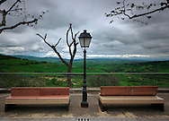 An overcast day in the hills surrounding Monticchiello, a small village atop a hill in the area of Orcia Valley just south of Siena, Italy