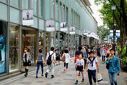 Busy shopping street in elegant Omotesando district of Tokyo Japan