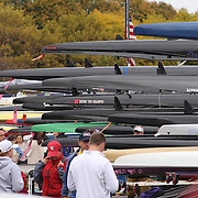 Crews prepare for competition in the autumn setting during The 49th Head of the Charles Regatta on the Charles River which separates Boston and Cambridge, Massachusetts, USA. The Head of Charles began in 1965, is the worlds largest two day rowing event with over 9000 competitors from around the globe competing. The course is 3 miles (4,800 meters) long and stretches from the start at Boston University's DeWolfe Boathouse near the Charles River Basin, passing Harvard University to the finish just after the Eliot Bridge. Boston, Massachusetts, USA. 19th October 2013. Photo Tim Clayton