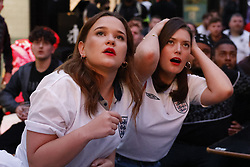 © Licensed to London News Pictures. 18/06/2021. London, UK. Fans react to the EURO 2020 England v Scotland match seen on a large screen at Boxpark Croydon in south London. Photo credit: Peter Macdiarmid/LNP