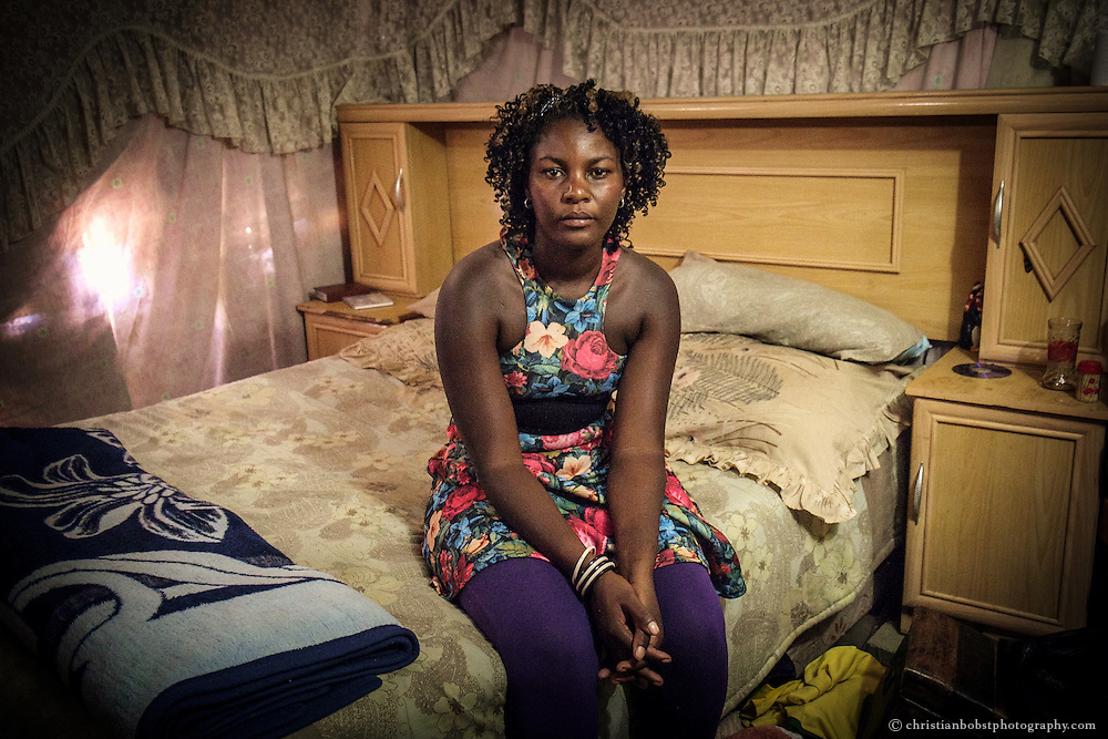 """(2013) Alexia (28) became pregnant by her father at the age of thirteen. Her relatives chased her away from home. She survived by doing sex work for more than ten years. With Father Hermann´s help, Alexia now runs a little shop that allows her to make a living. """"He gave me back my dignity"""" Alexia says about the priest."""