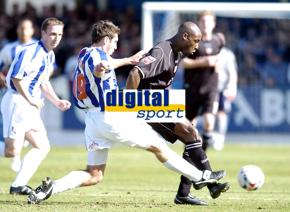 Photo: Olly Greenwood.<br />Colchester United v Brentford. Coca Cola League 1. 01/04/2006. Brentfords Marcus Gayle and Colchesters Garry Richards.