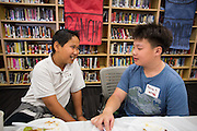 Fifth grader Vu Nguyen, left, and sixth grader Darren Tang, of Weller, talk with break the ice together during the Jack Emery Drive Brunch at Milpitas High School in Milpitas, California, on November 3, 2015. (Stan Olszewski/SOSKIphoto)