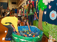 """""""Spring"""" is in the air for Freshman Anthony Gentile, Lauren Camella and Chloe Bourgeois as they the pond in their hallway on Thursday evening in preparation for Gilford High School's Homecoming festivities.   (Karen Bobotas/for the Laconia Daily Sun)"""