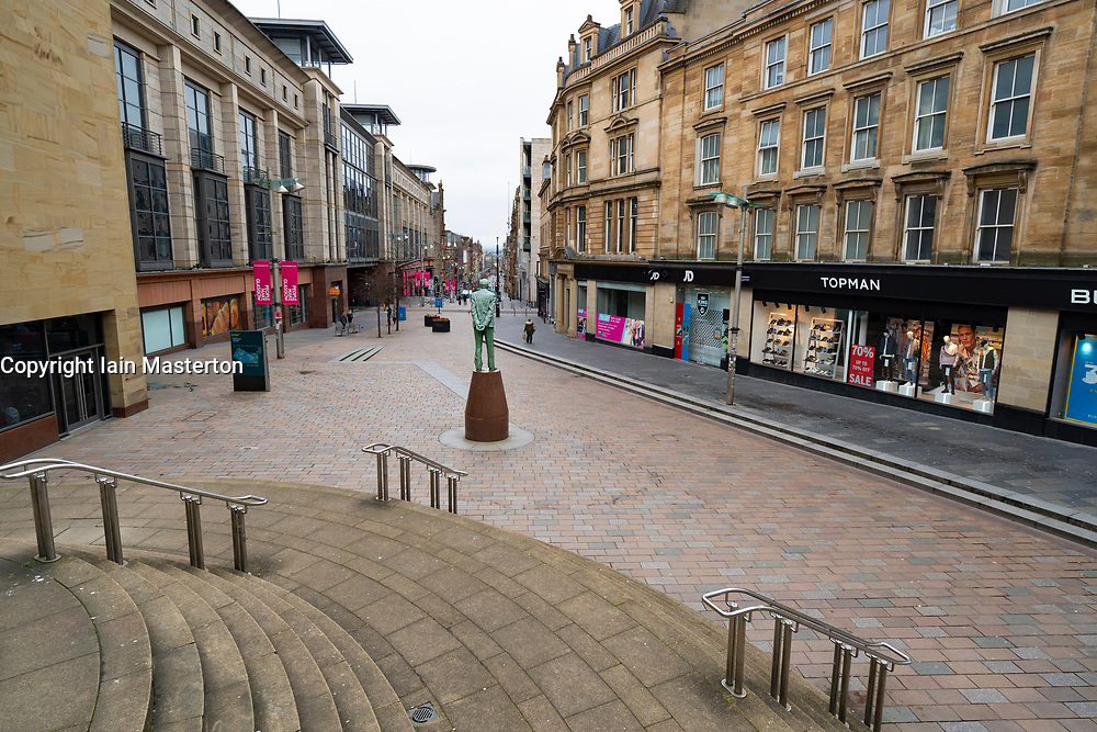 Glasgow, Scotland, UK. 26 March, 2020. Views from city centre in Glasgow on Thursday during the third day of the Government sanctioned Covid-19 lockdown. The city is largely deserted. Only food and convenience stores open. Pictured; Empty streets around statue of Donald Dewar on on Buchanan Street. Iain Masterton/Alamy Live News
