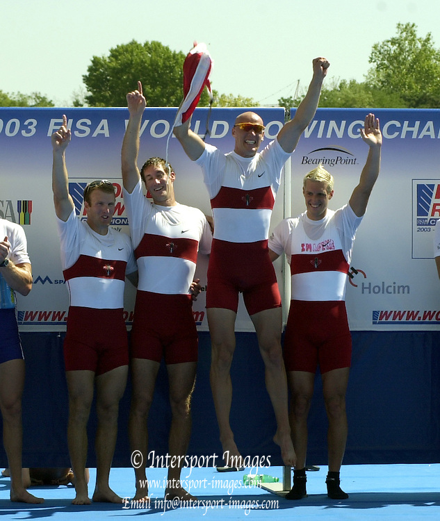 © Peter Spurrier/Sports Photo .email pictures@rowingpics.com tel +44 7973 819 551.Photo  Peter Spurrier.30/08/2003 Saturday.2003 World Rowing Championships, Idroscala. Milan, Italy.  {A Finals] .Men's four awards dock .CAN M4-Cameron Baerg, Thomas Herschmiller, Jake Wetzel and  Barney Williams Milan. ITALY 2003 World Rowing Championships. Idro Scala Rowing Course. [Mandatory Credit: Peter Spurrier: Intersport Images.]