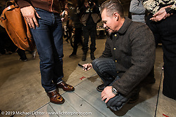 Jeff Decker snaps some cool shoes at the Annual Mooneyes Yokohama Hot Rod and Custom Show. Japan. Sunday, December 7, 2014. Photograph ©2014 Michael Lichter.