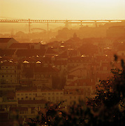 Houses of Alcântara district in front of the 25th of April bridge, Lisbon, Portugal