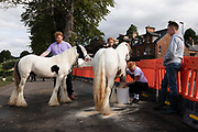 A group of men wash their horses as they arrive at Appleby Horse Fair, the biggest gathering of Gypsies and travellers in Europe, on 14th August, 2021 in Appleby, United Kingdom. Appleby Horse Fair attracts thousands from Gypsy, Romany, and traveller communities annually, making it the biggest gathering of its kind in Europe. Generally held for a week every June, the fair was postponed in 2020 and pushed forward to August in 2021 due to Coronavirus.