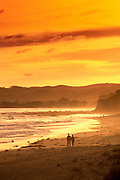 Image of a couple on the beach at sunset at Anglesea, Victoria, Australia, model released by Randy Wells