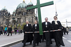 April 14, 2017 - Berlin, Berlin, Germany - Bishop MARKUS DROEGE, Archbishop HEINER KOCH, SEYRAN ATES, representing for the Islamic communities, together with Clerics and Members of the Berlin congregations along with several hundred people carry a green cross during the annual Good Friday procession in Berlin. (Credit Image: © Jan Scheunert via ZUMA Wire)